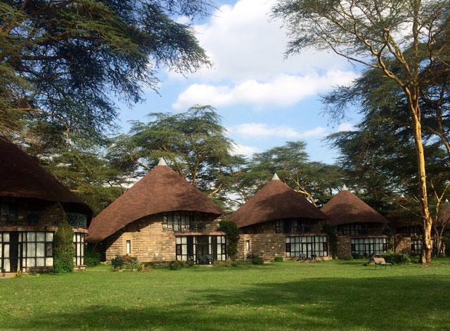 Sopa Lodges in Kenya cottages facing green grass
