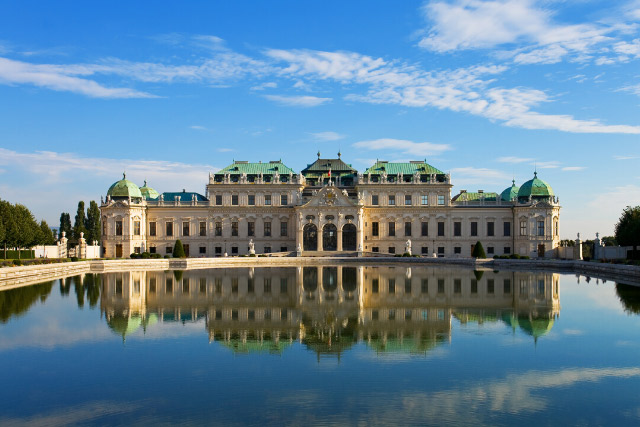 Reflection of palace building in water at Belvedere, Vienna