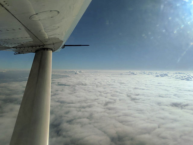 The view out of a Safarilink plane over the clouds