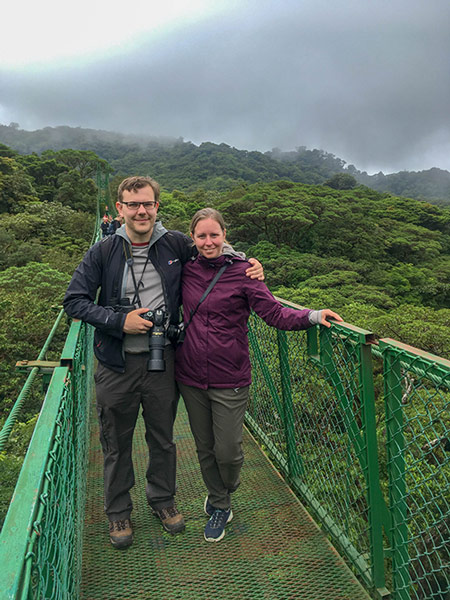 Couple on a hanging bridge in Monteverde